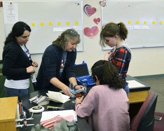 Students and Instructors working together on a STEM Kit