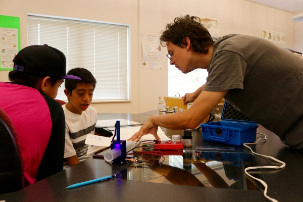 Students working on a STEM Kit with an instructor